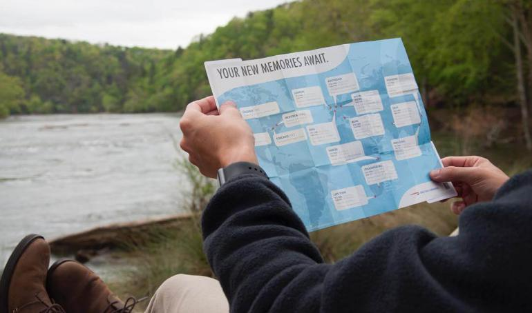 Gallery: Sitting by lake with pocket map